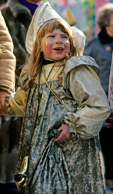[SWITZER.JURA 6375] 'Frightened fairy queen.'  Tuesday is children's carnival during the <i>Basler Fasnacht</i>, the carnival of Basel. Then the children rule and the parents obey. But it is tiring to play and play and play. And frightening sometimes, with so many weird characters walking around. Photo Paul Smit.