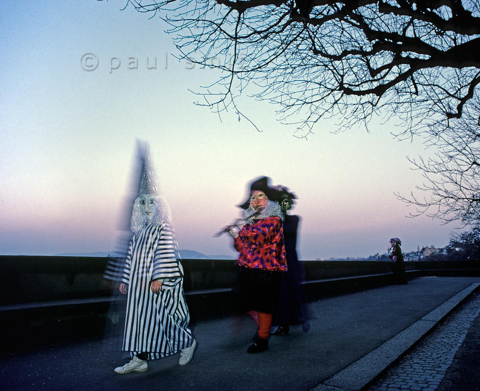 [SWITZER.JURA 6325]<br /> 'Nightfall during carnival in Basel.'<br /> <br /> Carnival continues day and night for 72 hours in Basel. One of the great moments each day is just after sunset along the Rhine (Rhein). It's the fairy tale hour. Photo Paul Smit.
