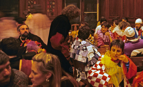 [SWITZER.JURA 6344] 'Basler Fasnacht indoors.'  Atmosphere in one of the traditional cafés of Basel during carnival. Cafés and restaurants are the only places where the masks are put down. Photo Paul Smit.