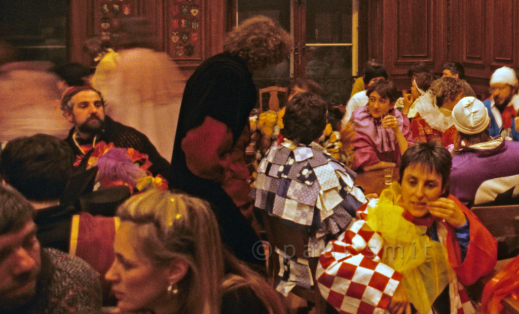 [SWITZER.JURA 6344]<br /> 'Basler Fasnacht indoors.'<br /> <br /> Atmosphere in one of the traditional cafés of Basel during carnival. Cafés and restaurants are the only places where the masks are put down. Photo Paul Smit.