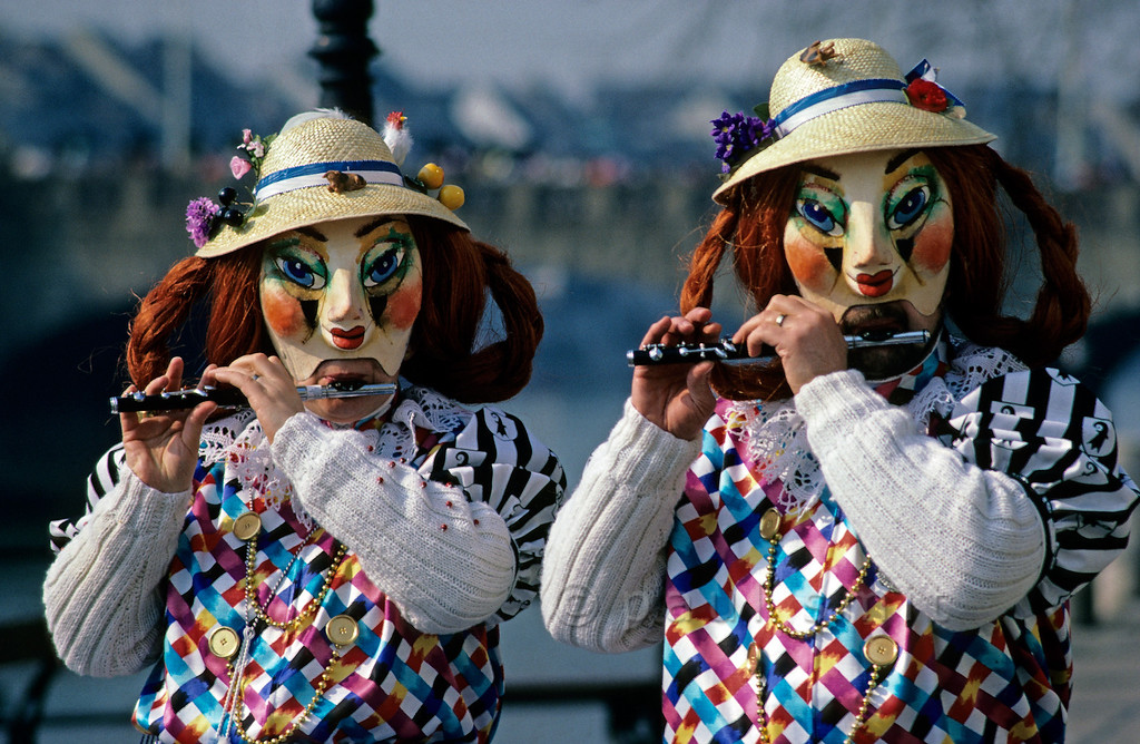 [SWITZER.JURA 6318]  'Whistling Old spinsters.'  During the <i>Basler Fasnacht</i> (carnival in Basel) two <i>Alti Dantes</i> (old spinsters) pipe while walking along the Rhine. Mind you, in daily life they are a couple. You can see the beard of the man, at right. Why do people pipe during the carnival - very loud, high pitched and seemingly chaotic - often for more then an hour in a row without stopping? That's what carnival, in its heathen origins, is all about: scaring away the winter! Photo Paul Smit.