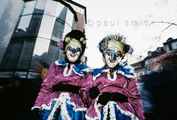 [SWITZER.JURA 6316] 'Old spinsters.'  In the early morning of the first day of the Basler Fasnacht (carnival of Basel) two Alti Dantes (old spinsters) dash through the streets of Basel. It is still before sunrise, the morning of the Morgestraich. Photo Paul Smit.