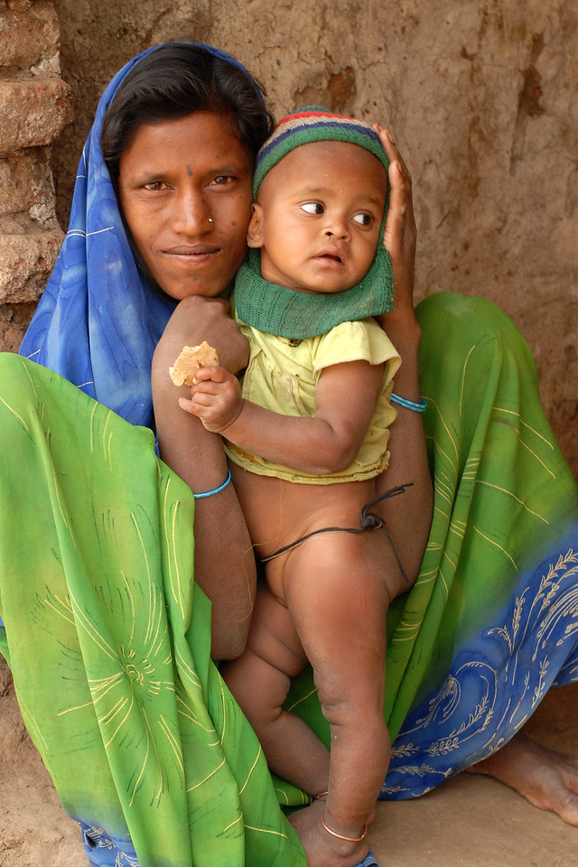 India: Loving mother and her daughter were sitting near their home in a village near Nagpur, Maharashtra. Jan 2007.