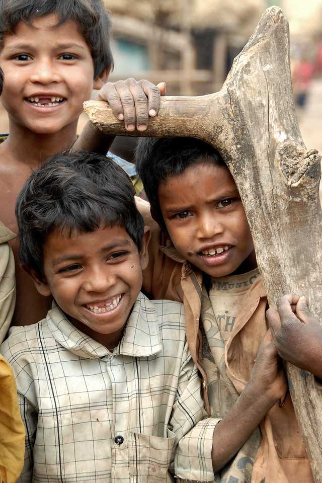 """India: """"Smiling India"""": As I was walking down the lanes of the village in near Nagpur, Maharashtra the children of the village started to follow me. They were very excited when I turned to them to take their picture. Jan 2007."""