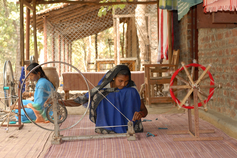 Thread used in the hand made cloth from the locally grown cotton which is sold in the market. Gandhi's charkha comes to mind on seeing these improvised bycycle-machines.