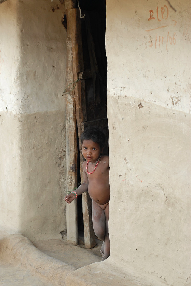 India: Saw this little girl standing outside the door to her house in a village near Nagpur, Maharashtra, India.