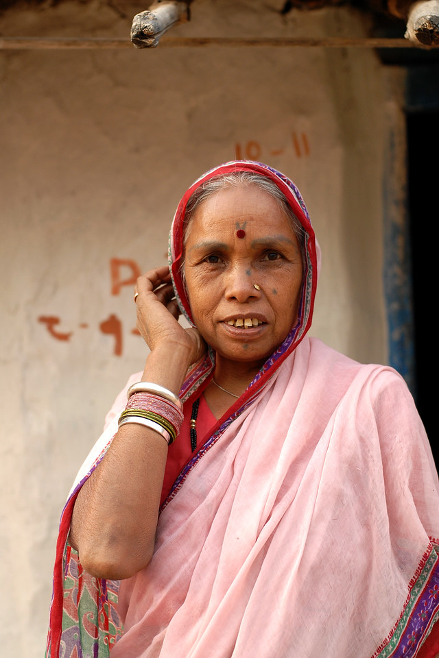 India: Portrait of an elder lady in a village near Nagpur, Maharashtra. Often religious symbols and names of Gods or the husband is tatooed on the arm of the wife and vise versa for the men. Seen here is a symbol tatooted on her face. Jan 2007.