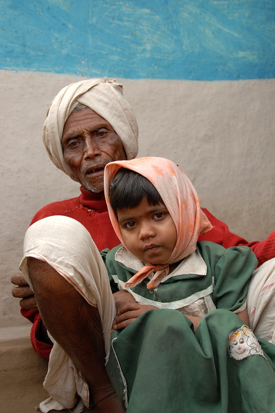 """India: """"Grandfather with the little girl"""": As I was taking the picture of the old man, he called out to his young grand daughter and asked her to sit with him for this picture.<br /> Jan 2007."""