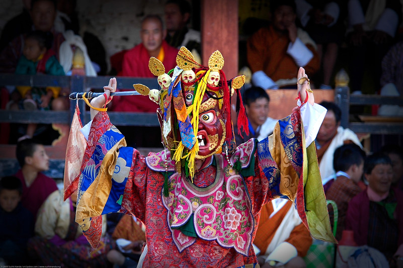 Masked dance at the Paro Tseche Festival of Dance. Paro, Bhutan. South Asia