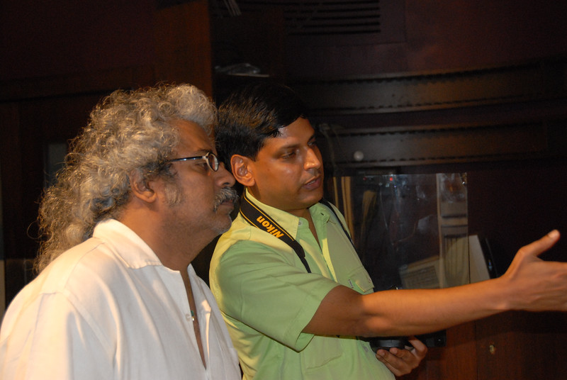Hariharan with Venky looking at his pictures.