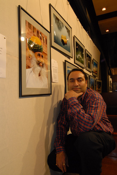 """Suchit with his pictures behind him. """"A tribute to photography"""". Invite for the """"Foto Expo"""" of Powai Photographers held from 1st September to 3rd September 2006 at Rodas Hotel Powai, Mumbai. Thousands of these flyer were circulated for the show. September 2006."""