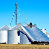 Several grain bins, located about three miles north of Toledo off Burma Road, were flattened by straight-line winds.
