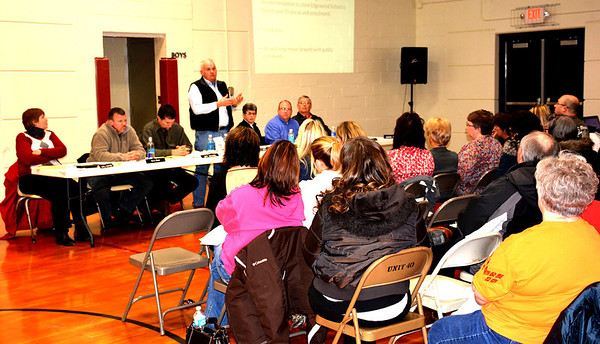 Effingham Unit 40 School Board President Del Soltwedel addressed citizens in the Edgewood Grade School gymnasium at a special board meeting about the possible closure of the school.