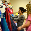 Andrea Wendling, left, and Alex Teasley, right, shop for dresses at the prom dress sale at Altamont Immanuel Saturday