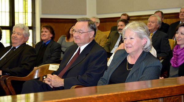 Judge Sherri L.E. Tungate, right, and Illinois Supreme Court Justice Lloyd Karmeier listen to comments made at Tungate's retirement ceremony Saturday. Tungate is leaving the Fourth Circuit bench after 20 years.