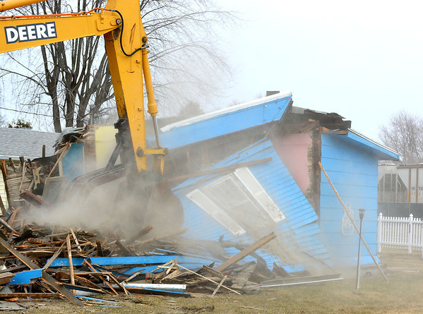 This home in the 300 block of North Merchant was being demolished Monday afternoon. There was no word on what would be done with the lot.