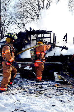 Firefighters put out a fire at a home that was declared a total loss. The home was located approximately 5 miles west of Beecher City.