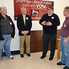 Executive Director Travis Akin of Illinois Lawsuit Abuse Watch, second from right, explains his position Tuesday to a group of public officials including, from left, Effingham County Board Vice Chairman David Campbell, state Rep. Brad Halbrook, and County Board Chairman Jim Niemann.
