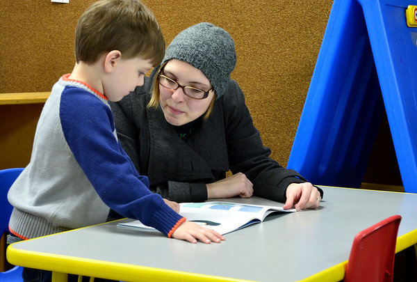 AJ Kersey and and his mother, Melissa Kersey, read a book at Young Readers Night at Altamont Grade School.