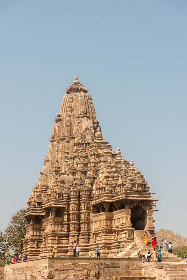 Fine detailed stone carvings at Khajuraho. Khajuraho - Land Of The Moon God is located in the Indian state of Madhya Pradesh (MP) and roughly 620 kilometers (385 miles) southeast of New Delhi. Khajuraho was the cultural capital of the Chandela Rajputs.