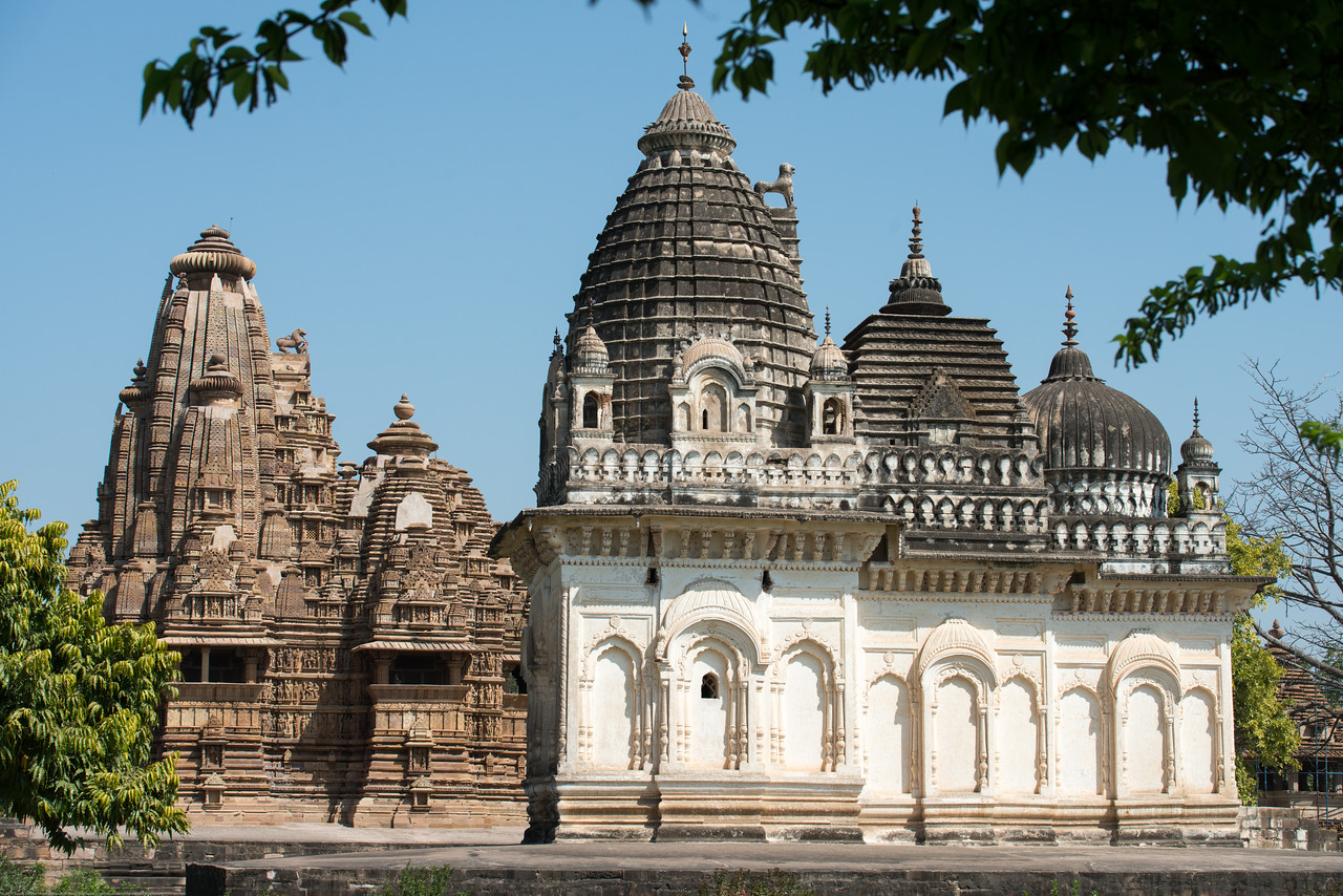 Khajuraho. Khajuraho - Land Of The Moon God is located in the Indian state of Madhya Pradesh (MP) and roughly 620 kilometers (385 miles) southeast of New Delhi. Khajuraho was the cultural capital of the Chandela Rajputs.