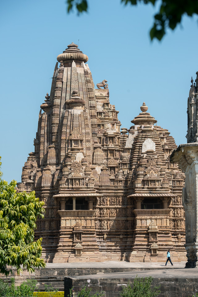Khajuraho Temple Complex. Khajuraho - Land Of The Moon God is located in the Indian state of Madhya Pradesh (MP) and roughly 620 kilometers (385 miles) southeast of New Delhi. Khajuraho was the cultural capital of the Chandela Rajputs.
