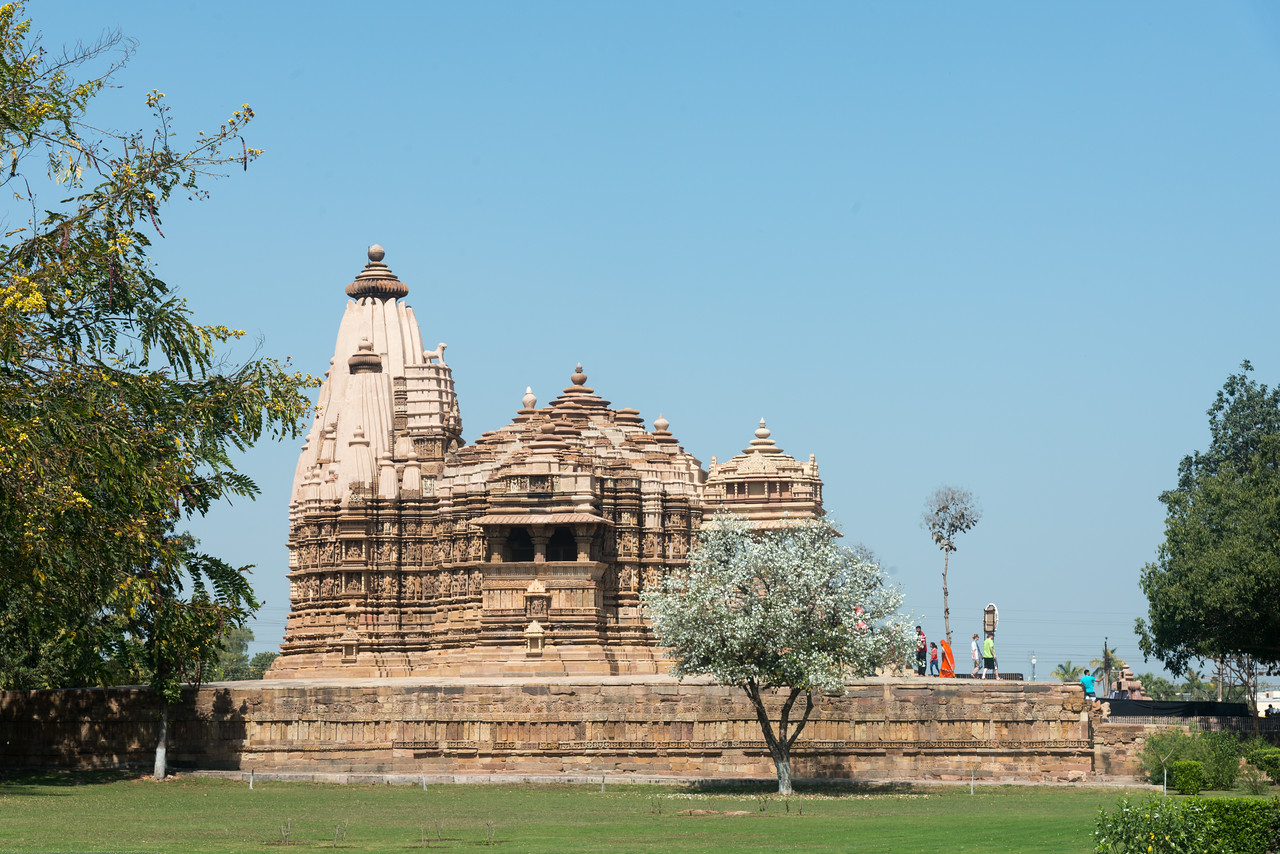 The Chitragupta temple is an 11th century temple of Surya in the Khajuraho town of Madhya Pradesh, India. Architecturally, it is very similar to the nearby Jagadambi temple. Khajuraho - Land Of The Moon God is located in the Indian state of Madhya Pradesh (MP) and roughly 620 kilometers (385 miles) southeast of New Delhi. Khajuraho was the cultural capital of the Chandela Rajputs.<br /> <br /> Architecturally they are unique. While each temple has a distinct plan and design, several features are common to all. They are all built on high platforms, several metres off the ground. The stone used throughout is either granite or a combination of light sandstone and granite. Each of these temples has an entrance hall or mandapa, and a sanctum sanctorum or garbha griha. The roofs of these various sections have a distinct form. The porch and hall have pyramidal roofs made of several horizontal layers. The inner sanctum's roof is a conical tower - a colossal pile of stone (often 30m high) made of an arrangement of miniature towers called shikharas.