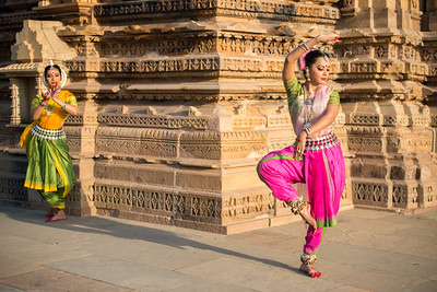 Namrata Mehta of Kaishiki, with Dhruvi Saachi Jaiin in the background. Khajuraho Dance Festival, Feb 2017. Colorful and brilliant classical dance forms of India with roots in the rich cultural traditions offer a feast for the eyes during a weeklong extravaganza. Khajuraho Temples in Madhya Pradesh are popular for their architectural wonders and sculptures.