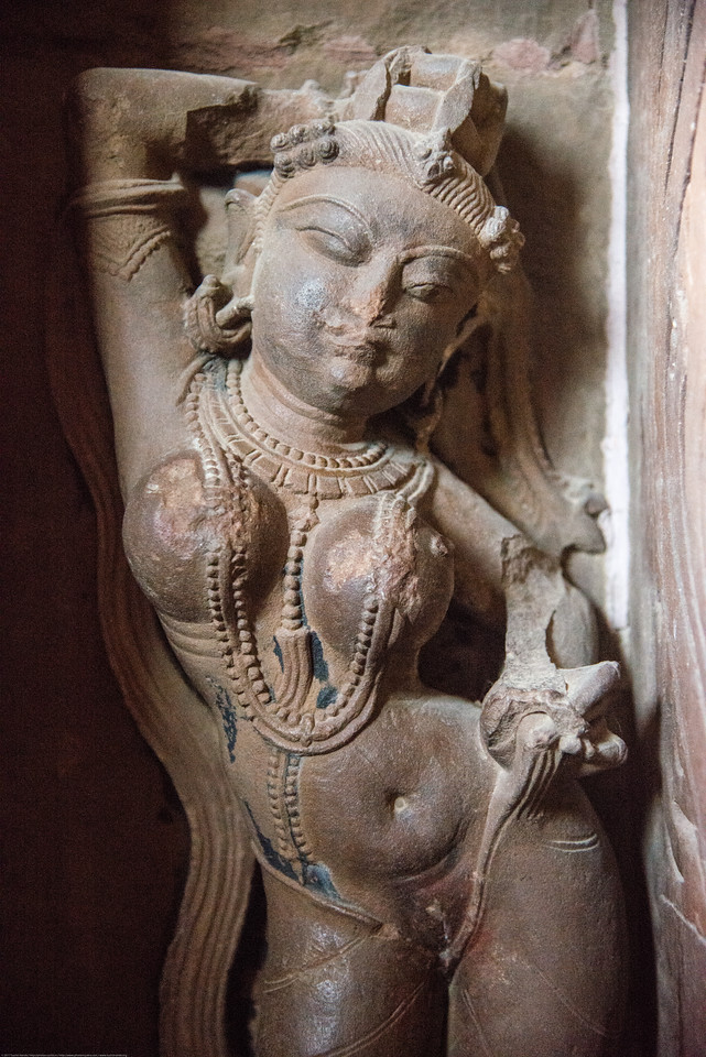 """Many statues were smashed by Islamic raiders during invasions. Khajuraho - Land Of The Moon God is located in the Indian state of Madhya Pradesh (MP) and roughly 620 kilometers (385 miles) southeast of New Delhi. Khajuraho was the cultural capital of the Chandela Rajputs, a Hindu dynasty that ruled from the 10th to 12th centuries. The temples of Khajuraho are famous for their so-called """"erotic sculptures"""". <br /> <br /> Symbolising a medieval legacy, the Khajuraho temples are a perfect fusion of architectural and sculptural excellence, representing one of the finest examples of Indian art. To some, they are the most graphic, erotic and sensuous sculptures the world has ever known. But Khajuraho has not received the attention it deserves for its significant contribution to the religious art of India - there are literally hundreds of exquisite images on the interior and exterior walls of the shrines.<br /> <br /> Architecturally they are unique. While each temple has a distinct plan and design, several features are common to all. They are all built on high platforms, several metres off the ground. The stone used throughout is either granite or a combination of light sandstone and granite. Each of these temples has an entrance hall or mandapa, and a sanctum sanctorum or garbha griha. The roofs of these various sections have a distinct form. The porch and hall have pyramidal roofs made of several horizontal layers. The inner sanctum's roof is a conical tower - a colossal pile of stone (often 30m high) made of an arrangement of miniature towers called shikharas."""