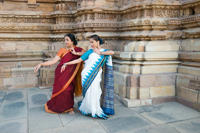 Tamanna Tanna with Odissi dance Guru Smt Daksha Mashruwala.  Khajuraho Dance Festival, Feb 2017. Colorful and brilliant classical dance forms of India with roots in the rich cultural traditions offer a feast for the eyes during a weeklong extravaganza. Khajuraho Temples in Madhya Pradesh are popular for their architectural wonders and sculptures.