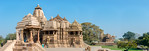 Panoramic view of Khajuraho Temple complex. Khajuraho - Land Of The Moon God is located in the Indian state of Madhya Pradesh (MP) and roughly 620 kilometers (385 miles) southeast of New Del ...