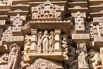 Stone carved statues at Khajuraho Temple complex. Khajuraho - Land Of The Moon God is located in the Indian state of Madhya Pradesh (MP) and roughly 620 kilometers (385 miles) southeast of N ...