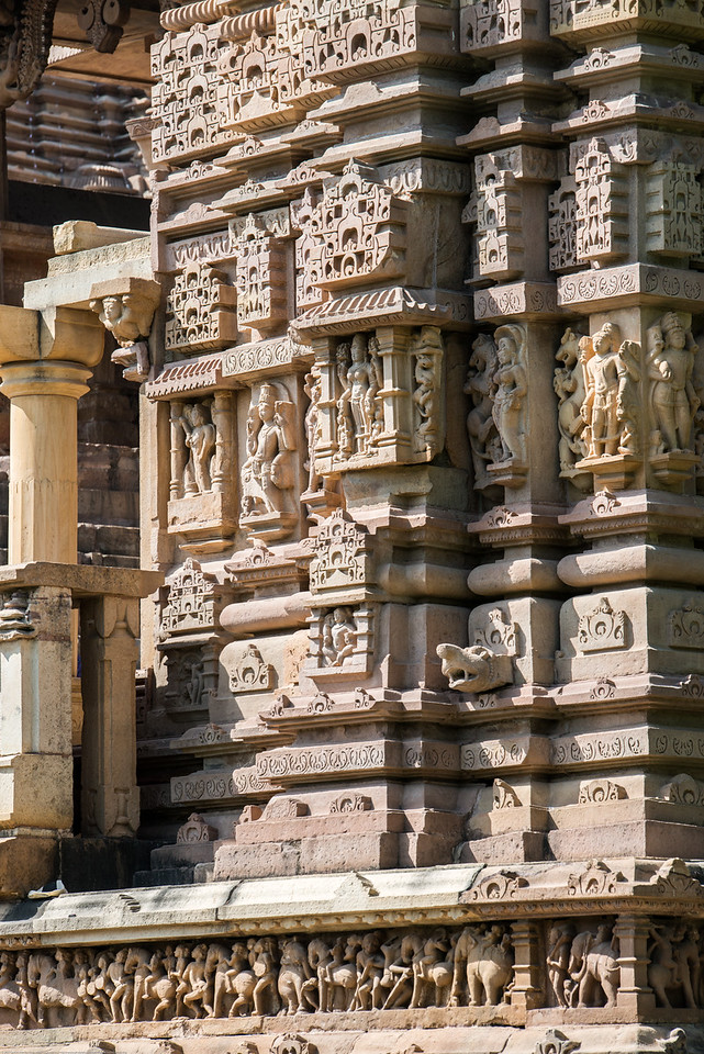 Fine detailed stone carvings on the exterior walls of Khajuraho Temples. Khajuraho - Land Of The Moon God is located in the Indian state of Madhya Pradesh (MP) and roughly 620 kilometers (385 miles) southeast of New Delhi. Khajuraho was the cultural capital of the Chandela Rajputs.