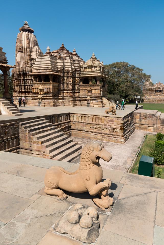 Devi Jagadambika temple or Jagadambika temple of a group of about 25 temples at Khajuraho, Madhya Pradesh, India. Khajuraho is a World Heritage site. Khajuraho - Land Of The Moon God is located in the Indian state of Madhya Pradesh (MP) and roughly 620 kilometers (385 miles) southeast of New Delhi. Khajuraho was the cultural capital of the Chandela Rajputs.<br /> <br /> The western complex of the Khajuraho group of temples houses the most important temples in Khajuraho. The Kandariya Mahadeva dedicated to Lord Shiva is the largest temple at Khajuraho. The Lakshmana temple dedicated to vishnu is located near the Kandariya Mahadeva temple. Devi Jagdamba Temple Chitragupta Temple Chaunsath Jogini Temple etc are the other major temple in the western complex.
