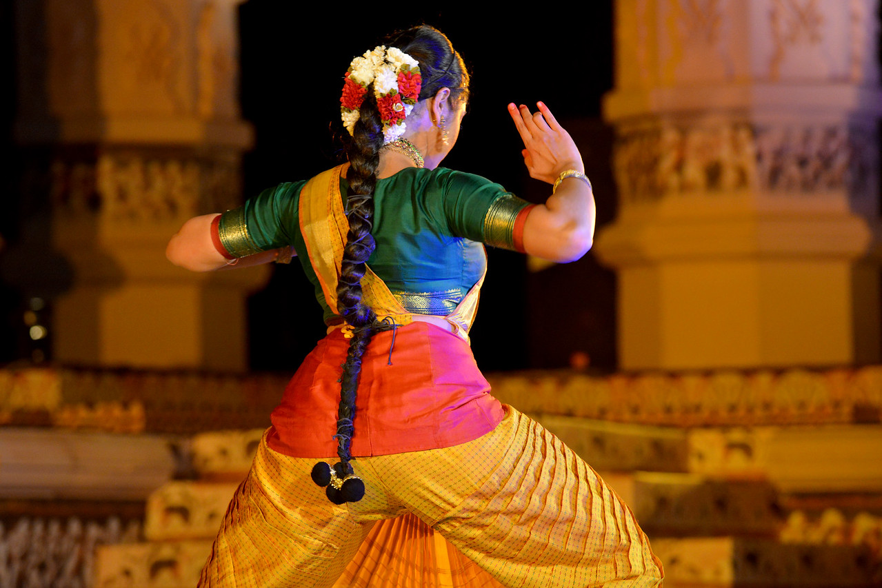 "Dakshina Vaidyanathan performs Bharatnatyam dance at the Khajuraho Festival of Dances, February, 2014.<br /> <br /> Khajuraho Festival of Dances is celebrated at a time when the hardness of winter begins to fade and the king of all seasons, spring, takes over. The most colorful and brilliant classical dance forms of India with their roots in the ling and rich cultural traditions across the country, offer a feast for the eyes during a weeklong extravaganza.<br /> <br /> Khajuraho is located in the Indian state of Madhya Pradesh and roughly 620 kilometers (385 miles) southeast of New Delhi, the temples of Khajuraho are famous for their so-called ""erotic sculptures"". Khajuraho was the cultural capital of the Chandela Rajputs, a Hindu dynasty that ruled from the 10th to 12th centuries."
