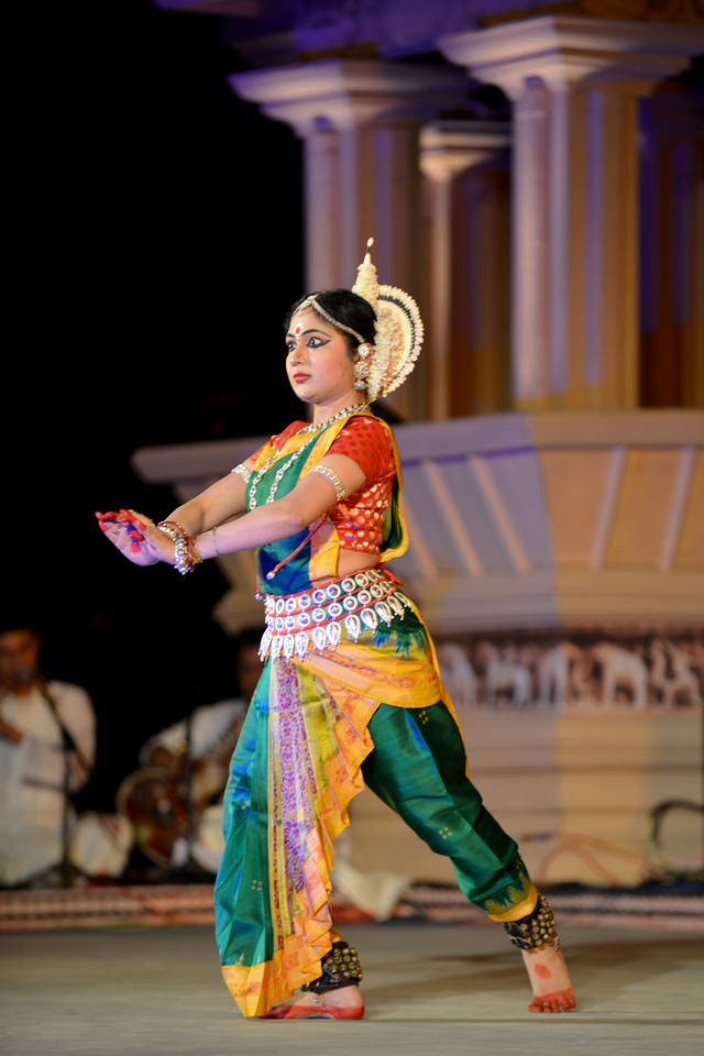 "Sanchita Banarjee, Delhi performed Odissi at the Khajuraho Festival of Dances February, 2014.<br /> <br /> Khajuraho Festival of Dances is celebrated at a time when the hardness of winter begins to fade and the king of all seasons, spring, takes over. The most colorful and brilliant classical dance forms of india with their roots in the ling and rich cultural traditions across the country, offer a feast for the eyes during a weeklong extravaganza.<br /> <br /> Khajuraho is located in the Indian state of Madhya Pradesh and roughly 620 kilometers (385 miles) southeast of New Delhi, the temples of Khajuraho are famous for their so-called ""erotic sculptures"". Khajuraho was the cultural capital of the Chandela Rajputs, a Hindu dynasty that ruled from the 10th to 12th centuries."