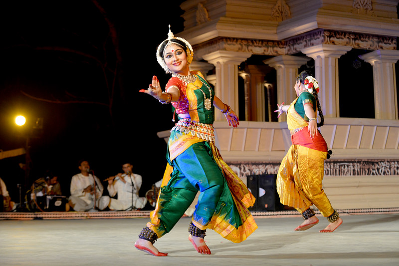 "Dakshina Vaidyanathan & Sanchita Banarjee, perform Bharatnatyam & Odissi dance at the Khajuraho Festival of Dances, February, 2014.  Khajuraho Festival of Dances is celebrated at a time when the hardness of winter begins to fade and the king of all seasons, spring, takes over. The most colorful and brilliant classical dance forms of India with their roots in the ling and rich cultural traditions across the country, offer a feast for the eyes during a weeklong extravaganza.  Khajuraho is located in the Indian state of Madhya Pradesh and roughly 620 kilometers (385 miles) southeast of New Delhi, the temples of Khajuraho are famous for their so-called ""erotic sculptures"". Khajuraho was the cultural capital of the Chandela Rajputs, a Hindu dynasty that ruled from the 10th to 12th centuries."