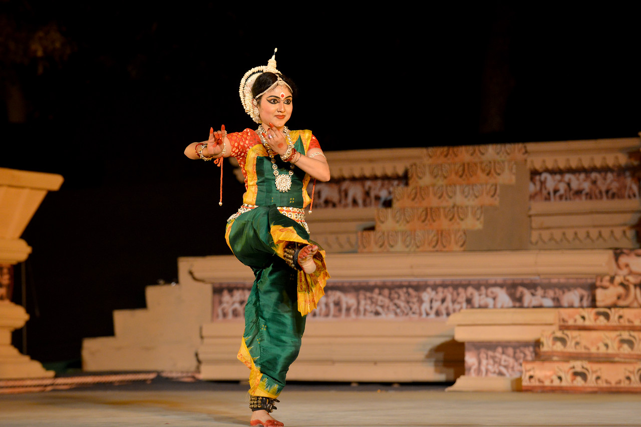 "Sanchita Banarjee performed the Odissi dance at the Khajuraho Festival of Dances, February, 2014.<br /> <br /> Khajuraho Festival of Dances is celebrated at a time when the hardness of winter begins to fade and the king of all seasons, spring, takes over. The most colorful and brilliant classical dance forms of India with their roots in the ling and rich cultural traditions across the country, offer a feast for the eyes during a weeklong extravaganza.<br /> <br /> Khajuraho is located in the Indian state of Madhya Pradesh and roughly 620 kilometers (385 miles) southeast of New Delhi, the temples of Khajuraho are famous for their so-called ""erotic sculptures"". Khajuraho was the cultural capital of the Chandela Rajputs, a Hindu dynasty that ruled from the 10th to 12th centuries."