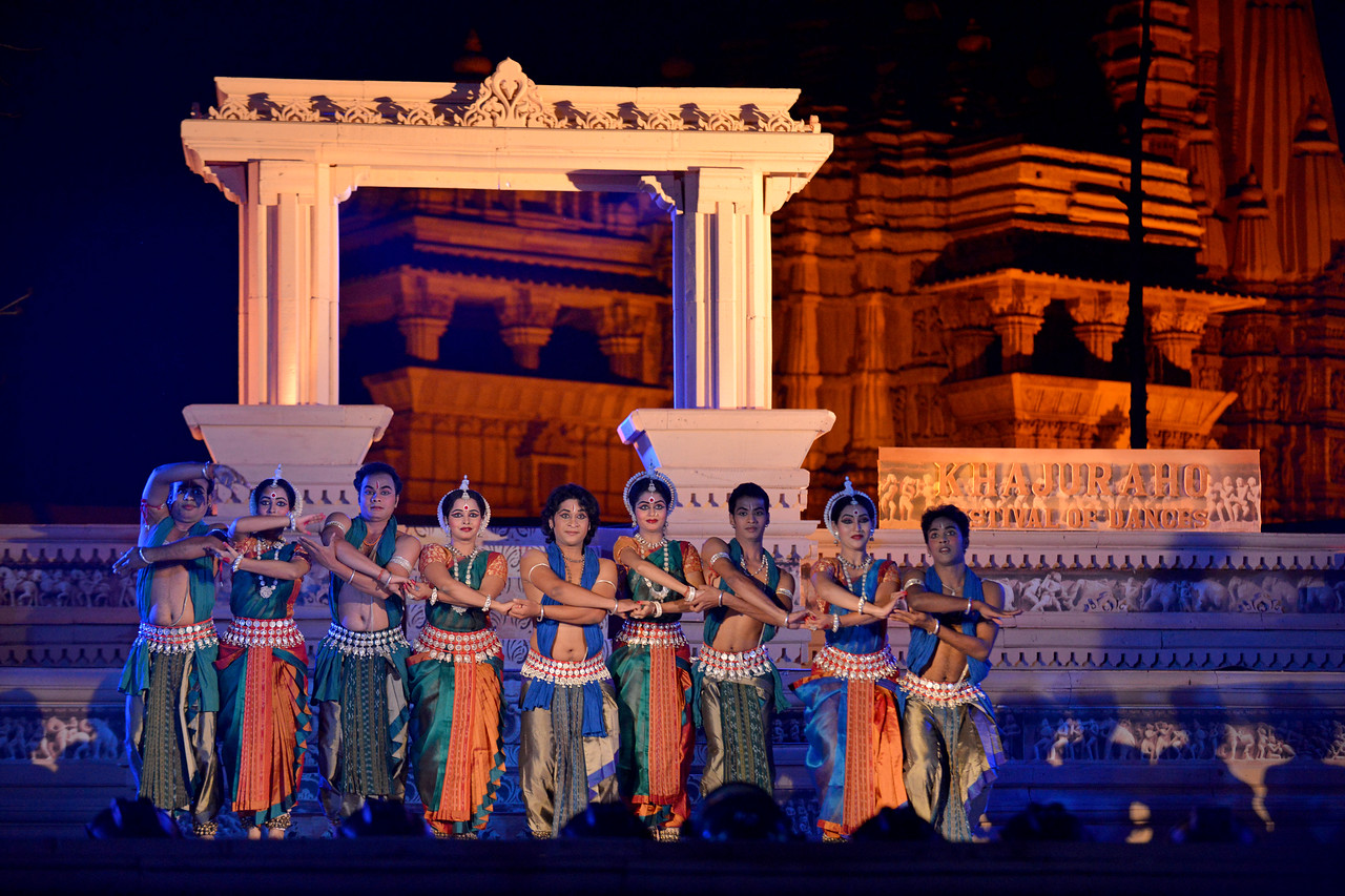 "Aruna Mohanti and Troupe, Odissi Group performed Odissi dance at the Khajuraho Festival of Dances, February, 2014.<br /> <br /> Khajuraho Festival of Dances is celebrated at a time when the hardness of winter begins to fade and the king of all seasons, spring, takes over. The most colorful and brilliant classical dance forms of India with their roots in the ling and rich cultural traditions across the country, offer a feast for the eyes during a weeklong extravaganza.<br /> <br /> Khajuraho is located in the Indian state of Madhya Pradesh and roughly 620 kilometers (385 miles) southeast of New Delhi, the temples of Khajuraho are famous for their so-called ""erotic sculptures"". Khajuraho was the cultural capital of the Chandela Rajputs, a Hindu dynasty that ruled from the 10th to 12th centuries."