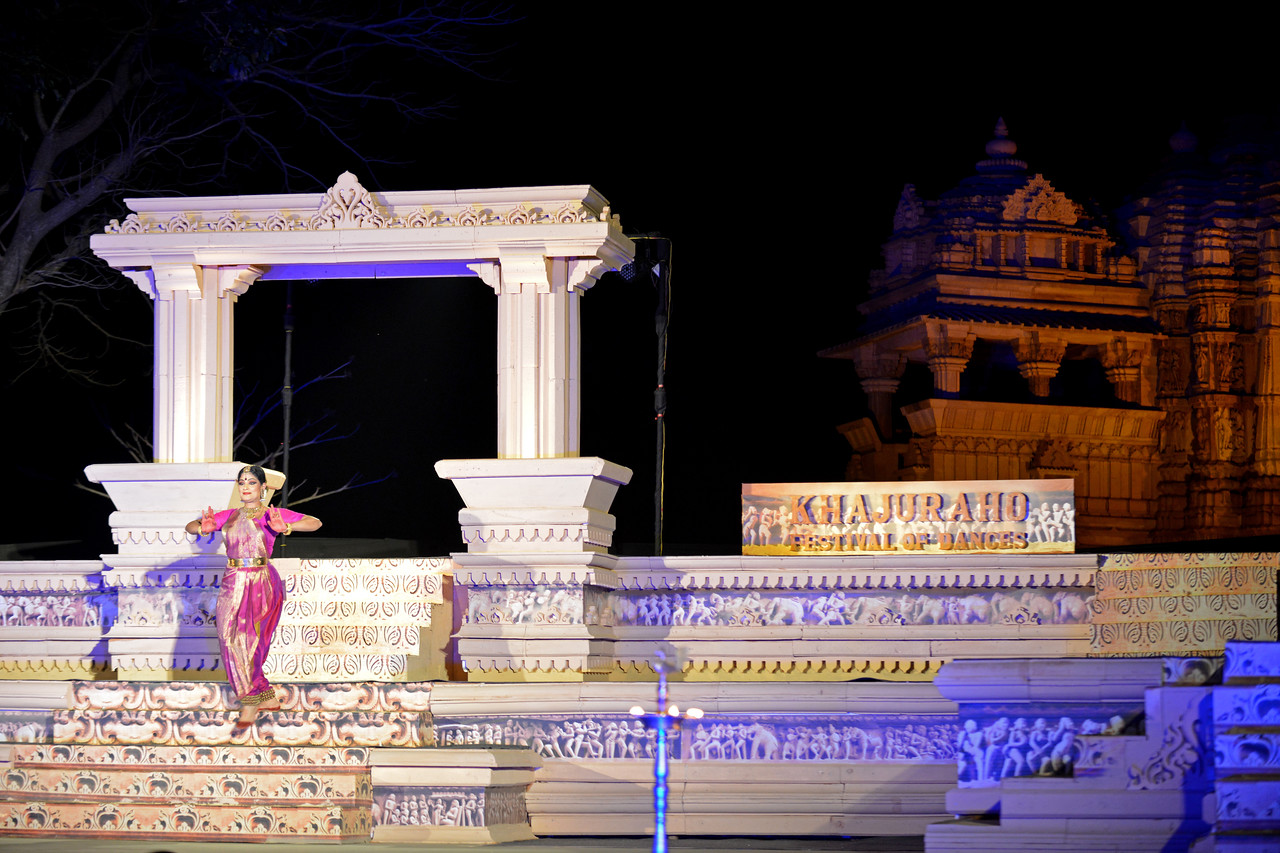 "Bharatnatyam dancer Geeta Chandran Founder, President, NATYA VRIKSHA, New Delhi at the Khajuraho Festival of Dances with the beautiful Khajuraho Temples at the back.<br /> <br /> This festival is celebrated at a time when the hardness of winter begins to fade and the king of all seasons, spring, takes over. The most colorful and brilliant classical dance forms of india with their roots in the ling and rich cultural traditions across the country, offer a feast for the eyes during a weeklong extravaganza.<br /> <br /> Khajuraho is located in the Indian state of Madhya Pradesh and roughly 620 kilometers (385 miles) southeast of New Delhi, the temples of Khajuraho are famous for their so-called ""erotic sculptures"". Khajuraho was the cultural capital of the Chandela Rajputs, a Hindu dynasty that ruled from the 10th to 12th centuries."