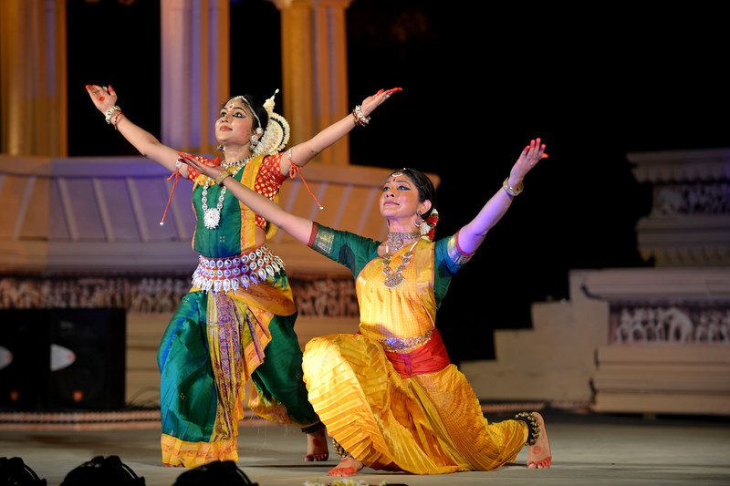 "Dakshina Vaidyanathan & Sanchita Banarjee performed Bharatnatyam & Odissi dance at the Khajuraho Festival of Dances, February, 2014.  Khajuraho Festival of Dances is celebrated at a time when the hardness of winter begins to fade and the king of all seasons, spring, takes over. The most colorful and brilliant classical dance forms of India with their roots in the ling and rich cultural traditions across the country, offer a feast for the eyes during a weeklong extravaganza.  Khajuraho is located in the Indian state of Madhya Pradesh and roughly 620 kilometers (385 miles) southeast of New Delhi, the temples of Khajuraho are famous for their so-called ""erotic sculptures"". Khajuraho was the cultural capital of the Chandela Rajputs, a Hindu dynasty that ruled from the 10th to 12th centuries."