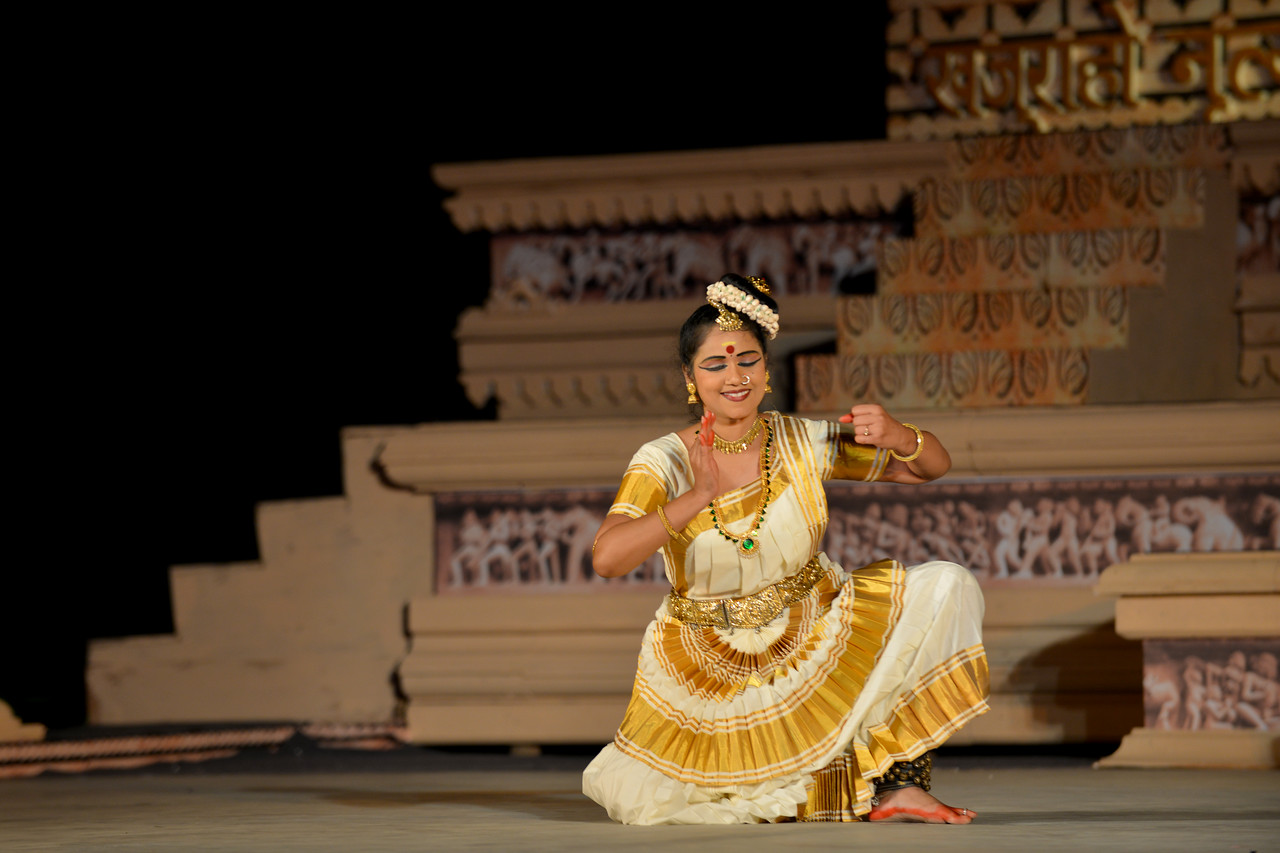 "Sujata Nair Sanjay performed the Mohini Attam dance at the Khajuraho Festival of Dances, February, 2014.<br /> <br /> Khajuraho Festival of Dances is celebrated at a time when the hardness of winter begins to fade and the king of all seasons, spring, takes over. The most colorful and brilliant classical dance forms of India with their roots in the ling and rich cultural traditions across the country, offer a feast for the eyes during a weeklong extravaganza.<br /> <br /> Khajuraho is located in the Indian state of Madhya Pradesh and roughly 620 kilometers (385 miles) southeast of New Delhi, the temples of Khajuraho are famous for their so-called ""erotic sculptures"". Khajuraho was the cultural capital of the Chandela Rajputs, a Hindu dynasty that ruled from the 10th to 12th centuries."