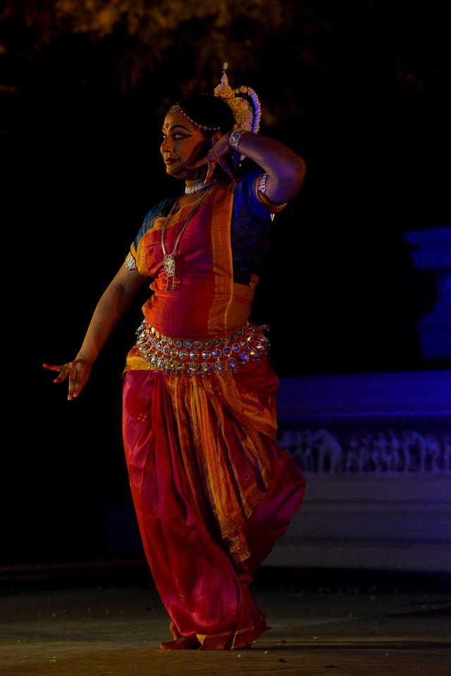 """Nibedita Mohapatra performed Odissi, dance at the Khajuraho Festival of Dances February, 2014.<br /> <br /> Khajuraho Festival of Dances is celebrated at a time when the hardness of winter begins to fade and the king of all seasons, spring, takes over. The most colorful and brilliant classical dance forms of India with their roots in the ling and rich cultural traditions across the country, offer a feast for the eyes during a weeklong extravaganza.<br /> <br /> Khajuraho is located in the Indian state of Madhya Pradesh and roughly 620 kilometers (385 miles) southeast of New Delhi, the temples of Khajuraho are famous for their so-called """"erotic sculptures"""". Khajuraho was the cultural capital of the Chandela Rajputs, a Hindu dynasty that ruled from the 10th to 12th centuries."""