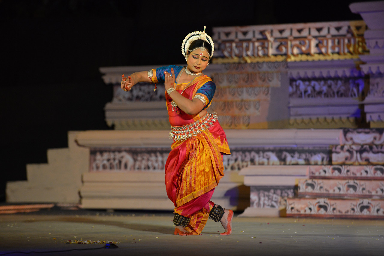 """Nibedita Mohapatra, performed Odissi dance at the Khajuraho Festival of Dances February, 2014.<br /> <br /> Khajuraho Festival of Dances is celebrated at a time when the hardness of winter begins to fade and the king of all seasons, spring, takes over. The most colorful and brilliant classical dance forms of India with their roots in the ling and rich cultural traditions across the country, offer a feast for the eyes during a weeklong extravaganza.<br /> <br /> Khajuraho is located in the Indian state of Madhya Pradesh and roughly 620 kilometers (385 miles) southeast of New Delhi, the temples of Khajuraho are famous for their so-called """"erotic sculptures"""". Khajuraho was the cultural capital of the Chandela Rajputs, a Hindu dynasty that ruled from the 10th to 12th centuries."""