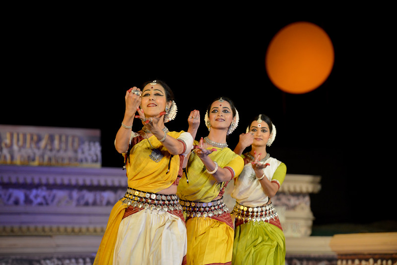 "Odissi performance by Bindu Juneja with Kalyani Phagre and Vaidehi Phagre at the Khajuraho Festival of Dances February, 2014.<br /> <br /> Khajuraho Festival of Dances is celebrated at a time when the hardness of winter begins to fade and the king of all seasons, spring, takes over. The most colorful and brilliant classical dance forms of India with their roots in the ling and rich cultural traditions across the country, offer a feast for the eyes during a weeklong extravaganza.<br /> <br /> Khajuraho is located in the Indian state of Madhya Pradesh and roughly 620 kilometers (385 miles) southeast of New Delhi, the temples of Khajuraho are famous for their so-called ""erotic sculptures"". Khajuraho was the cultural capital of the Chandela Rajputs, a Hindu dynasty that ruled from the 10th to 12th centuries."