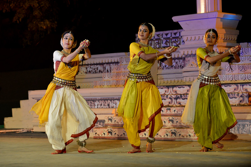 "Odissi performance by Bindu Juneja, Kalyani Phagre & Vaidehi Phagre at the Khajuraho Festival of Dances February, 2014.<br /> <br /> Khajuraho Festival of Dances is celebrated at a time when the hardness of winter begins to fade and the king of all seasons, spring, takes over. The most colorful and brilliant classical dance forms of India with their roots in the ling and rich cultural traditions across the country, offer a feast for the eyes during a weeklong extravaganza.<br /> <br /> Khajuraho is located in the Indian state of Madhya Pradesh and roughly 620 kilometers (385 miles) southeast of New Delhi, the temples of Khajuraho are famous for their so-called ""erotic sculptures"". Khajuraho was the cultural capital of the Chandela Rajputs, a Hindu dynasty that ruled from the 10th to 12th centuries."