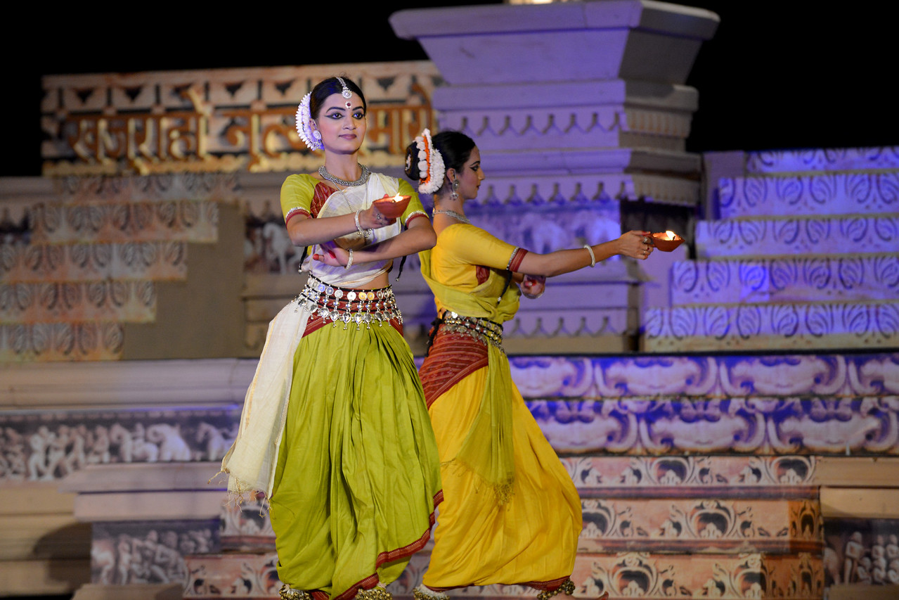 "Vaidehi Phagre and Kalyani Phagre. Odissi performance by Bindu Juneja at the Khajuraho Festival of Dances February, 2014.<br /> <br /> Khajuraho Festival of Dances is celebrated at a time when the hardness of winter begins to fade and the king of all seasons, spring, takes over. The most colorful and brilliant classical dance forms of India with their roots in the ling and rich cultural traditions across the country, offer a feast for the eyes during a weeklong extravaganza.<br /> <br /> Khajuraho is located in the Indian state of Madhya Pradesh and roughly 620 kilometers (385 miles) southeast of New Delhi, the temples of Khajuraho are famous for their so-called ""erotic sculptures"". Khajuraho was the cultural capital of the Chandela Rajputs, a Hindu dynasty that ruled from the 10th to 12th centuries."