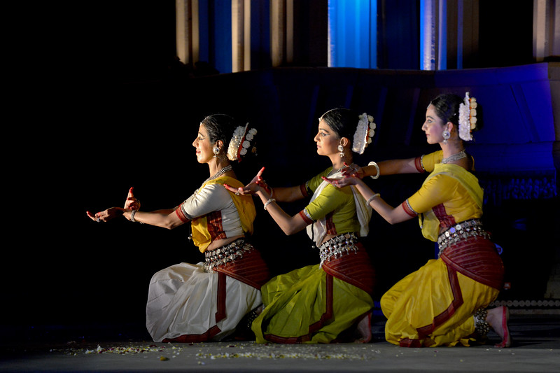 "Odissi performance by Bindu Juneja, Kalyani Phagre and Vaidehi Phagre at the Khajuraho Festival of Dances February, 2014.<br /> <br /> Khajuraho Festival of Dances is celebrated at a time when the hardness of winter begins to fade and the king of all seasons, spring, takes over. The most colorful and brilliant classical dance forms of India with their roots in the ling and rich cultural traditions across the country, offer a feast for the eyes during a weeklong extravaganza.<br /> <br /> Khajuraho is located in the Indian state of Madhya Pradesh and roughly 620 kilometers (385 miles) southeast of New Delhi, the temples of Khajuraho are famous for their so-called ""erotic sculptures"". Khajuraho was the cultural capital of the Chandela Rajputs, a Hindu dynasty that ruled from the 10th to 12th centuries."