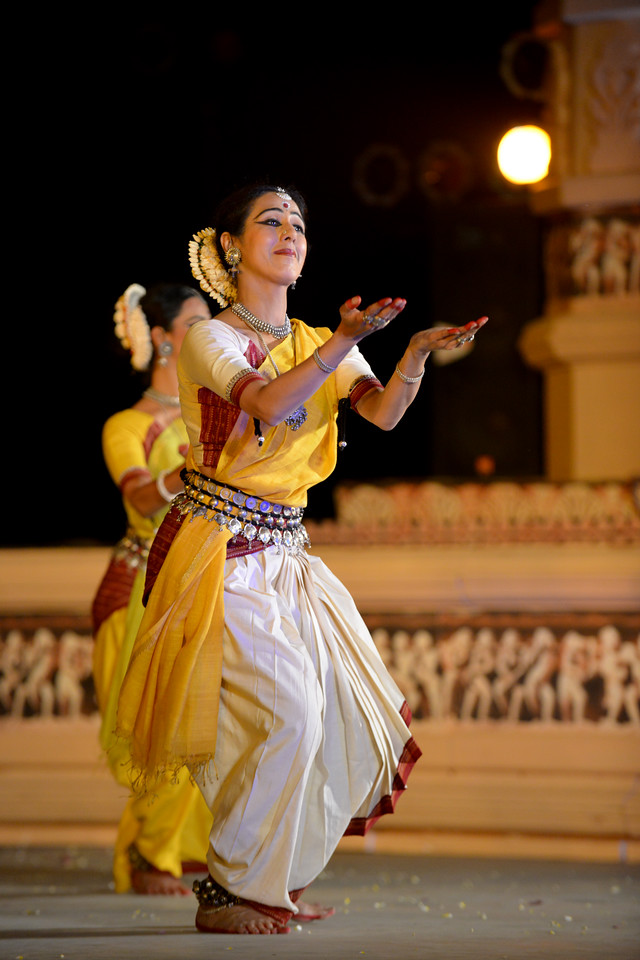"Odissi performance by Bindu Juneja at the Khajuraho Festival of Dances February, 2014.<br /> <br /> Khajuraho Festival of Dances is celebrated at a time when the hardness of winter begins to fade and the king of all seasons, spring, takes over. The most colorful and brilliant classical dance forms of India with their roots in the ling and rich cultural traditions across the country, offer a feast for the eyes during a weeklong extravaganza.<br /> <br /> Khajuraho is located in the Indian state of Madhya Pradesh and roughly 620 kilometers (385 miles) southeast of New Delhi, the temples of Khajuraho are famous for their so-called ""erotic sculptures"". Khajuraho was the cultural capital of the Chandela Rajputs, a Hindu dynasty that ruled from the 10th to 12th centuries."