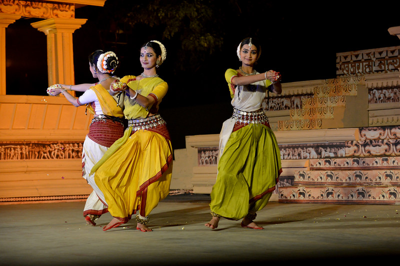 "Odissi performance by Bindu Juneja, Kalyani Phagre & Vaidehi Phagre at the Khajuraho Festival of Dances February, 2014.  Khajuraho Festival of Dances is celebrated at a time when the hardness of winter begins to fade and the king of all seasons, spring, takes over. The most colorful and brilliant classical dance forms of India with their roots in the ling and rich cultural traditions across the country, offer a feast for the eyes during a weeklong extravaganza.  Khajuraho is located in the Indian state of Madhya Pradesh and roughly 620 kilometers (385 miles) southeast of New Delhi, the temples of Khajuraho are famous for their so-called ""erotic sculptures"". Khajuraho was the cultural capital of the Chandela Rajputs, a Hindu dynasty that ruled from the 10th to 12th centuries."